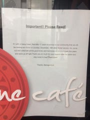 A closure announcement is posted on the door of Jasmine Cafe and Lounge. It's last day is Sunday.