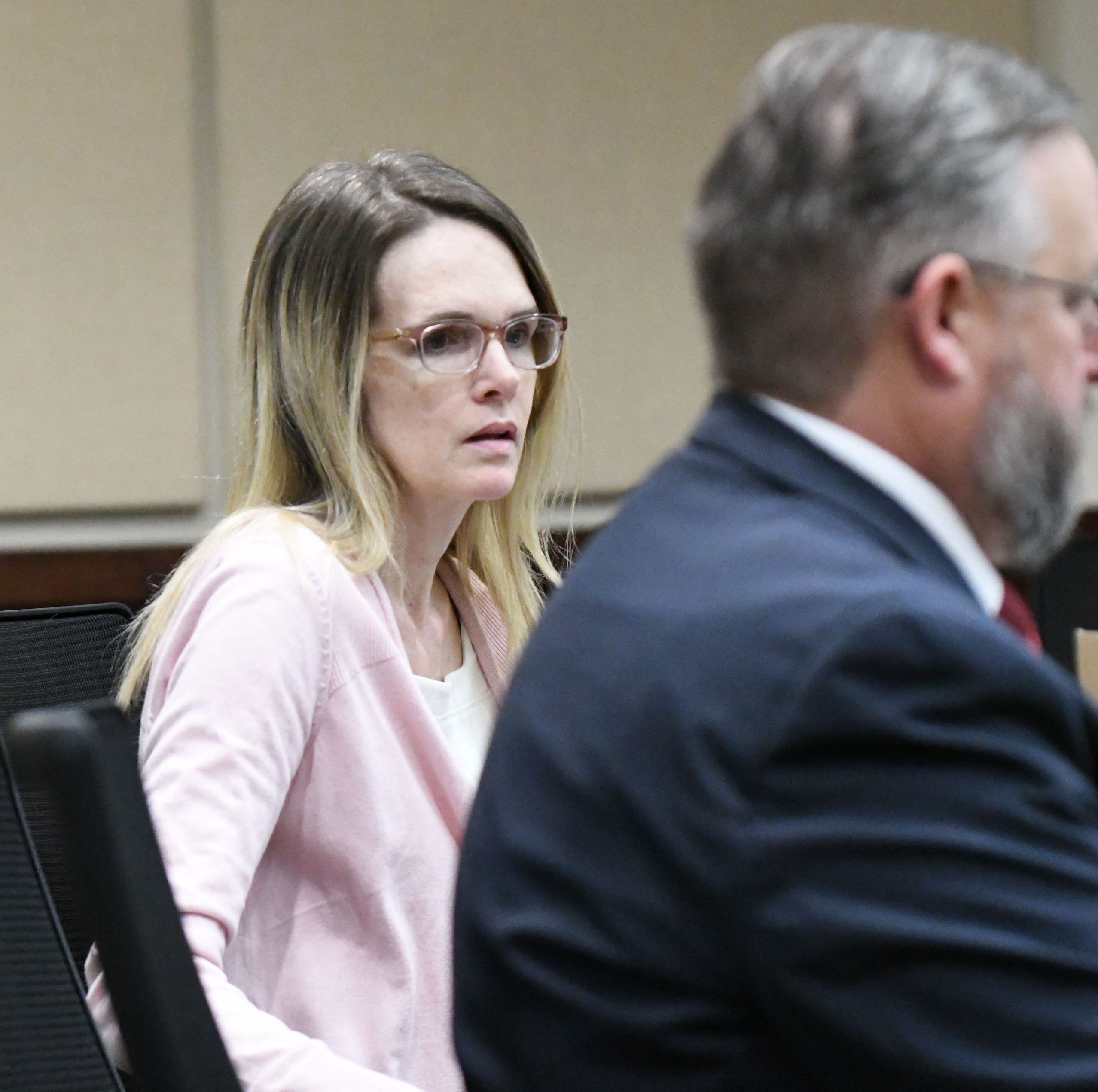Denise Williams dresses in a soft pink cardigan for her first day on trial for the murder of her husband, Mike Williams, Tuesday, Dec. 11, 2018.