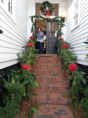 Sue Griner coming down the rear steps of the Tallahassee Garden Club.
