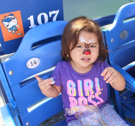 Mariaelena, 2, enjoys the perfect weather, chocolate and her favorite Christmas carol.