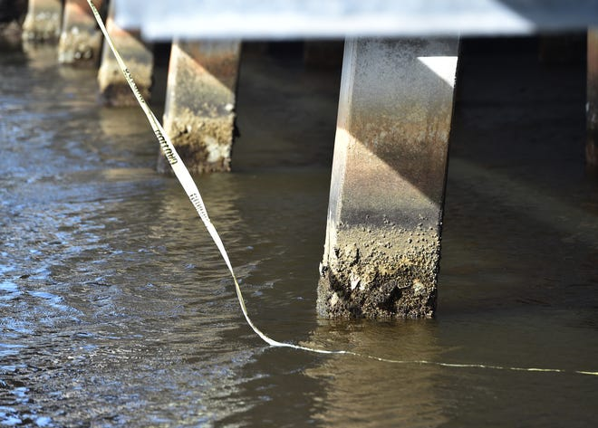 Barnacles and erosion are evident on the supports under the roadway of the bridge along Old Dixie Highway above Taylor Creek on Sunday, January 14, 2018, in Fort Pierce.