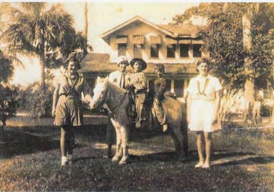 The Waldo Sexton house as seen in the 1930s after the second story is added. Siblings Barbara Sexton, left, and Jacqueline Sexton, right is with mom Elsebeth behind the horse and brothers Ralph Sexton, front, and Randy Sexton on the horse.