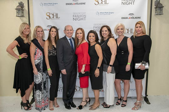 Dr. Sohl's Implant and Cosmetic Surgery, a sponsor of Treasure Coast Fashion Night, was represented by Christina Baxter, left, Cindy Smith, Mikenzie Hodson, Dr. Michael Sohl and Ixia Sohl, Sandy Alexander, Rosa Ceballos, Shelley Alley and Milly Mato.