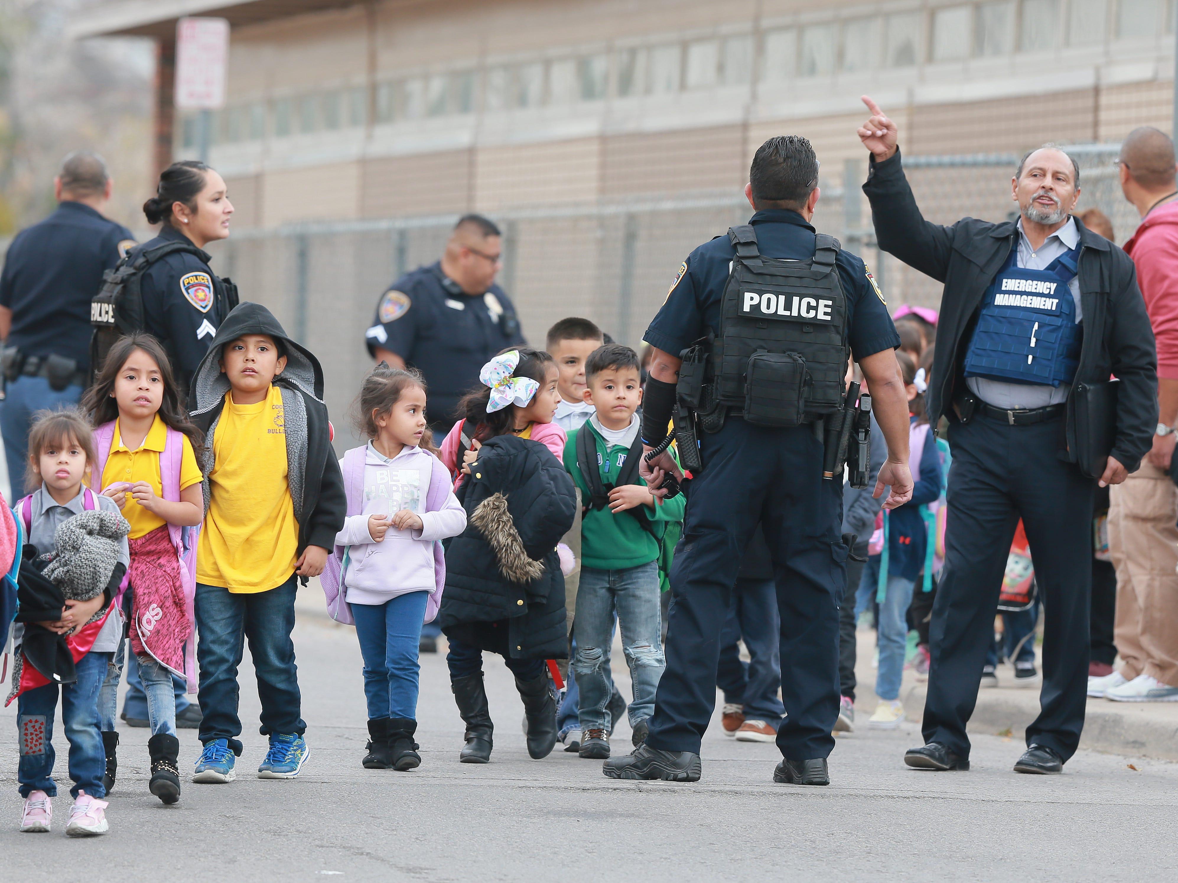 El Paso police officer shot, taken to hospital; suspect sought
