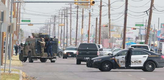 A SWAT team Tuesday joins the search for a suspect in the shooting of an El Paso police officer.