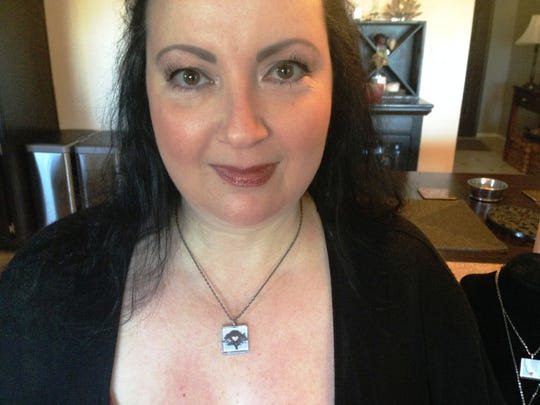 "Nancy Kanter, owner of Sparkling Vine Design in Newbury Park, wears one of the three pendants in her ""Love for California"" collection."