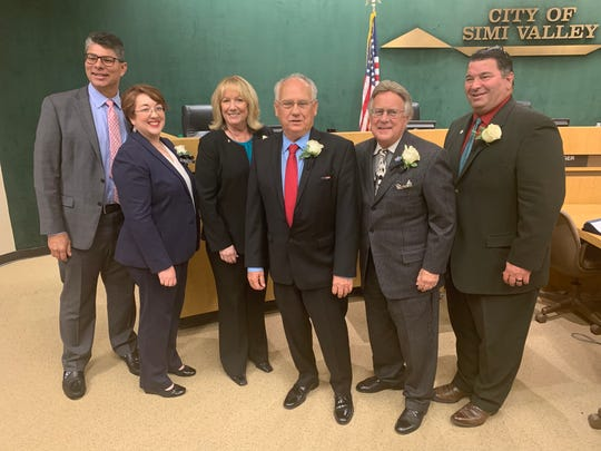 Former and present Simi Valley City Council members pose after the council's reorganization meeting Monday night. From left to right, retired member Glen Beccera, new member Ruth Luevanos, incumbent Dee Dee Cavanaugh, new Mayor Keith Mashburn, former Mayor Bob Huber and incumbent Mike Judge.