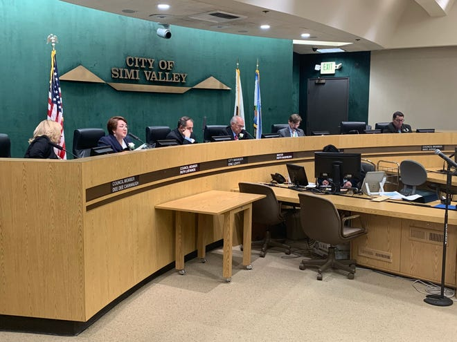 The reorganized Simi Valley City Council, including new Mayor Keith Mashburn (fourth from left) and new council member Ruth Luevanos (second from left) was seated Monday night.