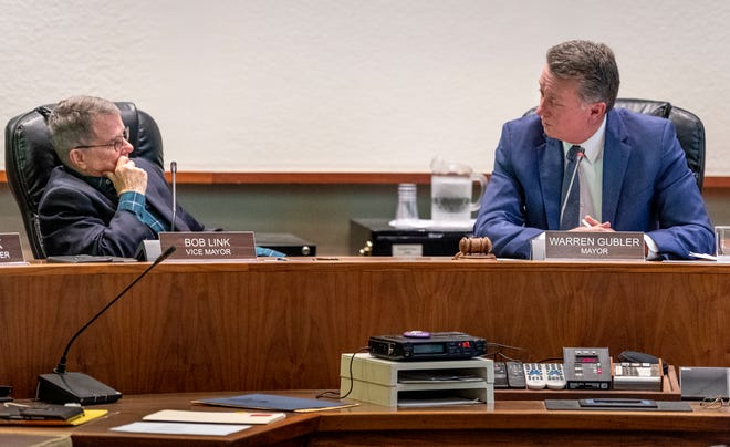Vice Mayor Bob Link, left, listens to outgoing Mayor Warren Gubler during the meeting on Monday, December 10, 2018. Link was named as Mayor later in the meeting.