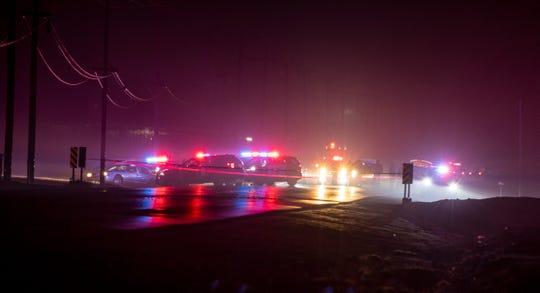 Tulare police and surrounding law enforcement investigate an officer-involved shooting on Tulare Avenue between Road 68 and Palm Road on Sunday, December 9, 2018.