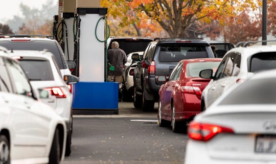 In December 2018, motorists wait to fuel up at a Costco in Visalia.