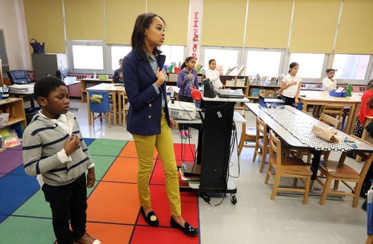 Substitute teacher Charisse Jett, who is on track to becoming a full-time teacher, and her class sing the Star Bangled Banner at Montessori School 27 in Yonkers Dec. 10, 2018. Jett's class includes first, second and third-graders.