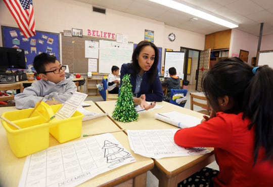 Substitute teacher Charisse Jett, who is on track to becoming a full-time teacher, works with second-grader Aaliyah Hernandez, right, and first-grader Brando Aviles on their journal entries at Montessori School 27 in Yonkers Dec. 10, 2018. Jett's class includes first, second and third-graders.