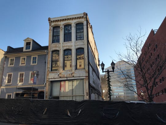 Two of the historic buildings on Market Street in downtown Wilmington that are set to be demolished for a new apartment building built by the Buccini/Pollin Group