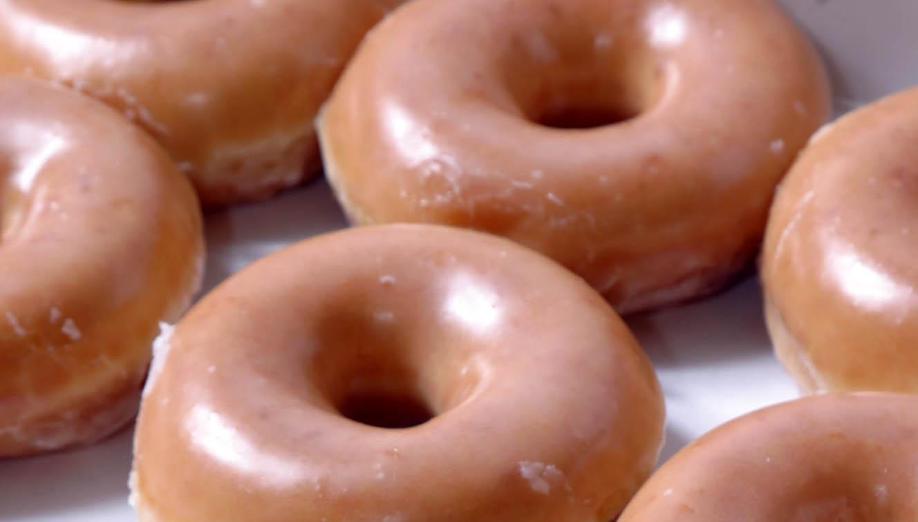 Buy a dozen Krispy Kreme glazed doughnuts on Dec. 12, and get a second dozen for $1.