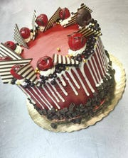 Customers can order confections like this chocolate cherry cake at Desserts by Dana in Newark.