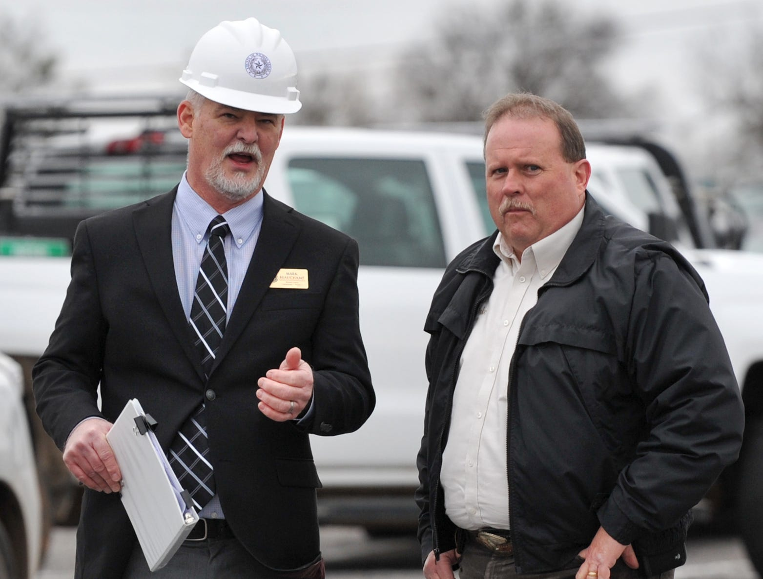 Wichita County Precinct 1 Commissioner, Mark Beachamp, left, and Wichita County Sheriff, David Duke chat before a groundbreaking ceremony held for the new law enforcement center that will be constructed next to the Sprague Annex.