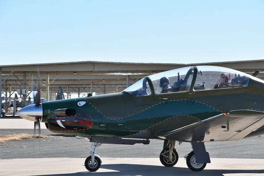 """Elf Pam"" lands at Sheppard Air Force Base Dec. 1 in a T-6. Pam and Santa Claus came to visit children at the 80th Flying Training Wing Christmas party."