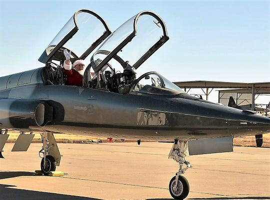 Santa Claus lands in at T-38 at Sheppard Air Force Base Dec. 1 to visit children at the 80th Flying Training Wing Christmas party.