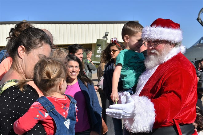 Santa Claus visits with children Dec. 1 at Sheppard Air Force Base at the 80th Flying Training Wing Christmas party.