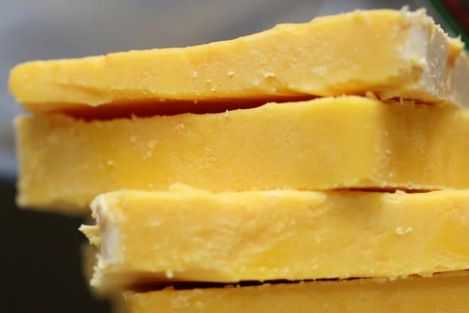 Customer lists show cheese intended for mink feed may have been bound for federal prisons to be used for inmate consumption in resale scheme.