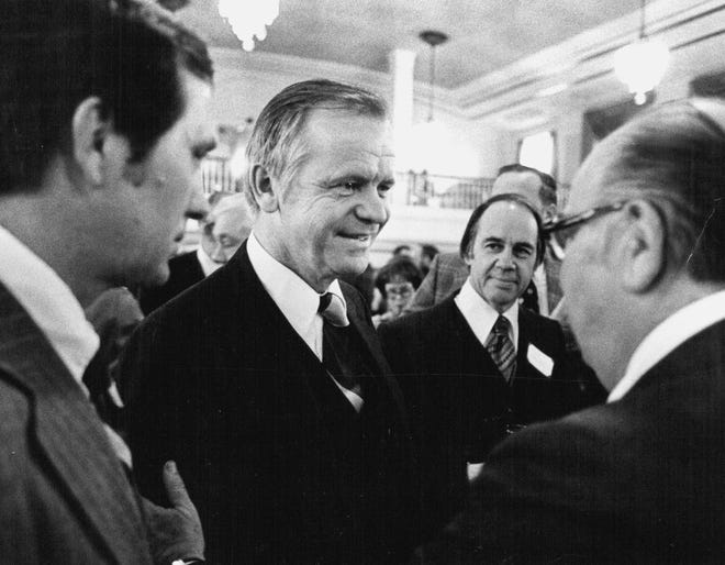 In a January 23, 1977 photo, Agriculture Secretary Bob Bergland, center, talks with guests at a National Press Club reception. Former U.S. Agriculture Secretary Bob Bergland died Sunday, Dec. 9, 2018 at a nursing home in Roseau, in northern Minnesota .