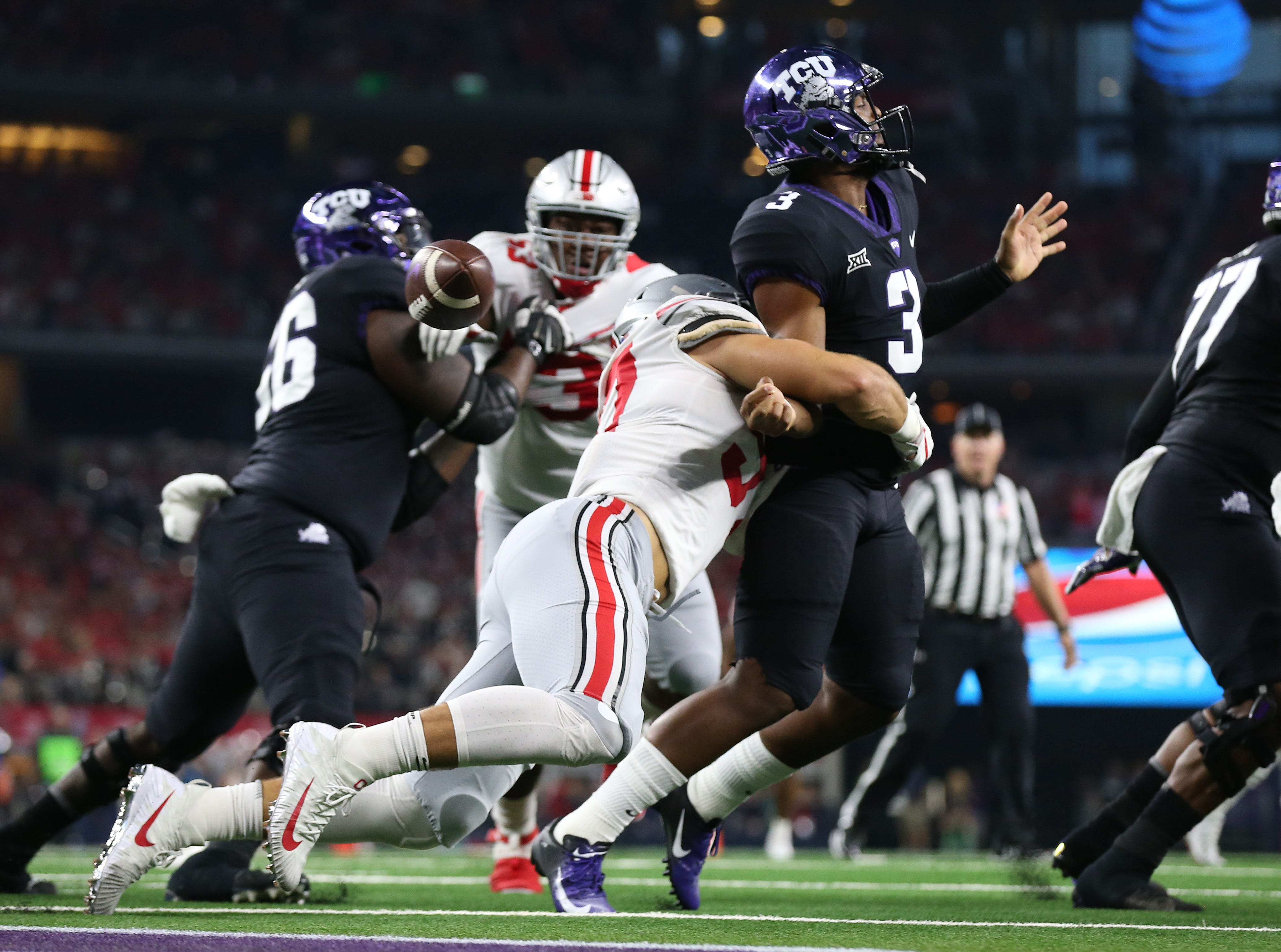 Sept. 15: TCU Horned Frogs quarterback Shawn Robinson (3) has the ball stripped by Ohio State Buckeyes defensive end Nick Bosa (97) at AT&T Stadium.