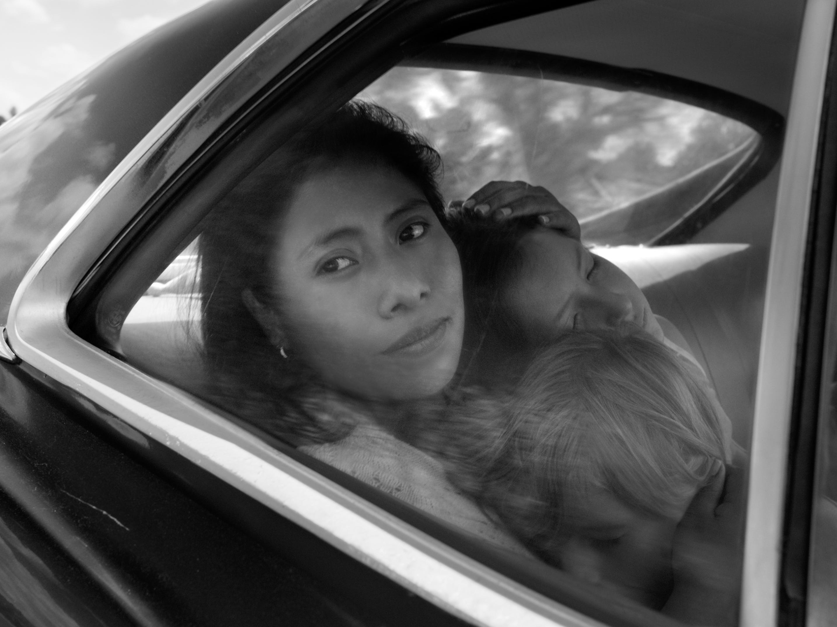 "Yalitza Aparicio as Cleo, Marco Graf as Pepe, and Daniela Demesa as Sofi iin the motion picture ""Roma,"" written and directed by Alfonso Cuarón.