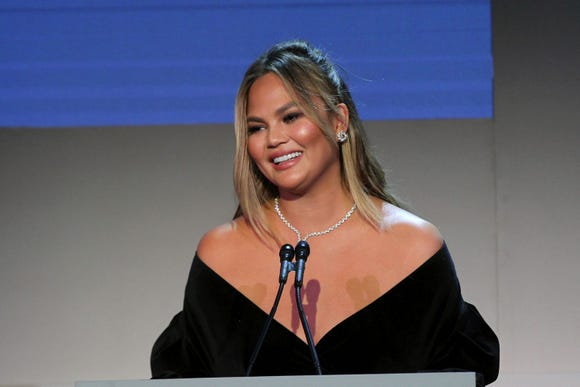 Chrissy Teigen's father, Ron Teigen Sr., got a tattoo of his daughter to celebrate her 33rd birthday.