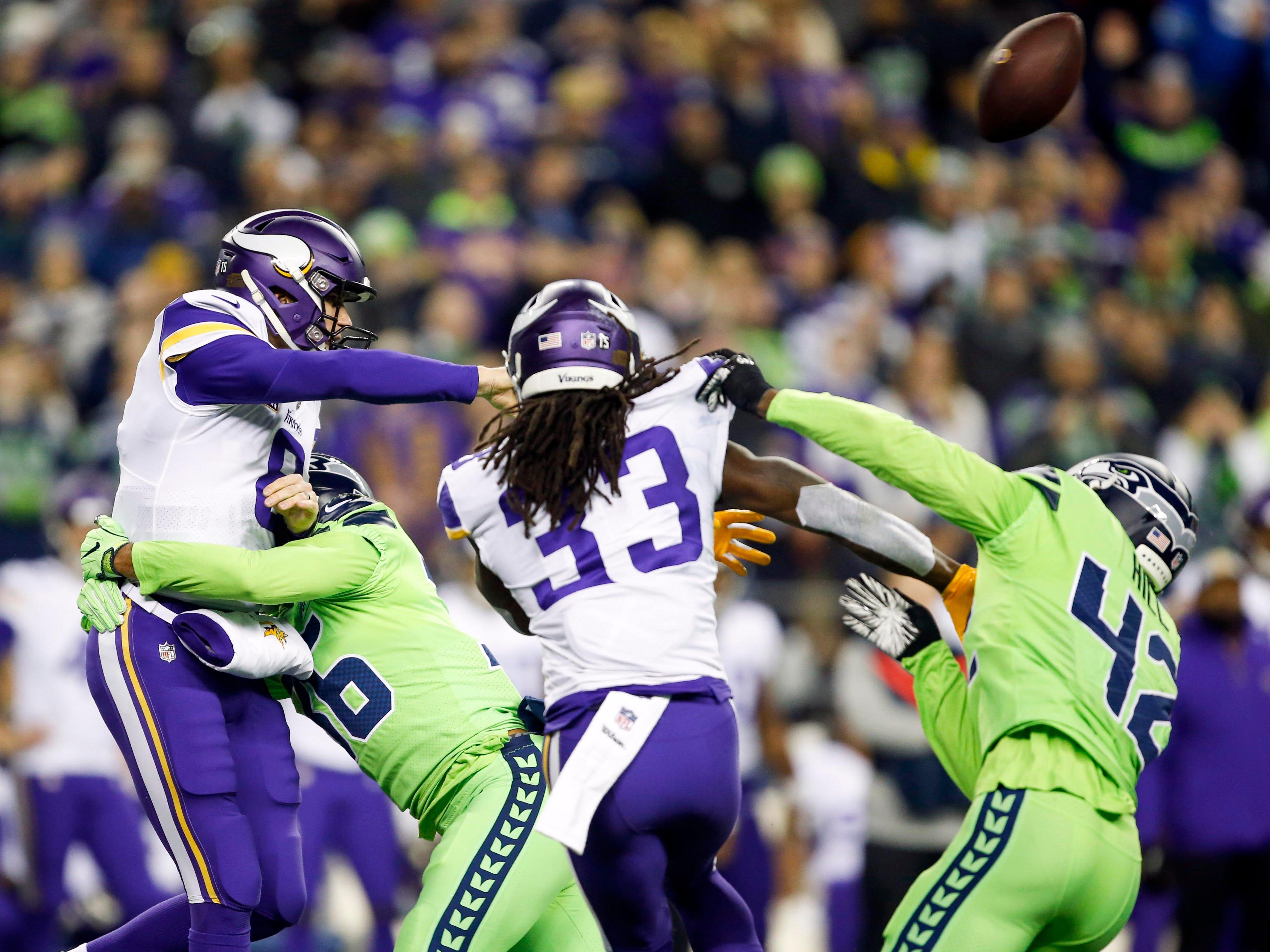 Minnesota Vikings quarterback Kirk Cousins passes under pressure from Seattle Seahawks cornerback Akeem King (36) during the first quarter at CenturyLink Field.