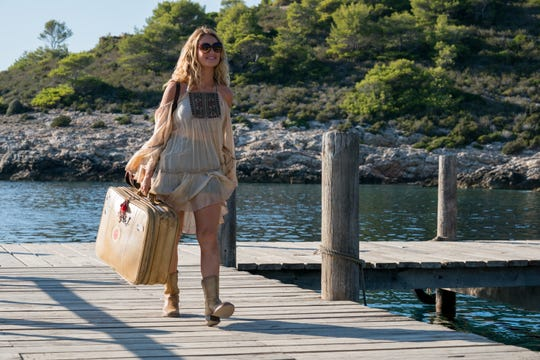 """LILY JAMES stars as Young Donna in """"Mamma Mia! Here We Go Again.""""  Ten years after """"Mamma Mia! The Movie,"""" you are invited to return to the magical Greek island of Kalokairi in an all-new original musical based on the songs of ABBA. [Via MerlinFTP Drop]"""