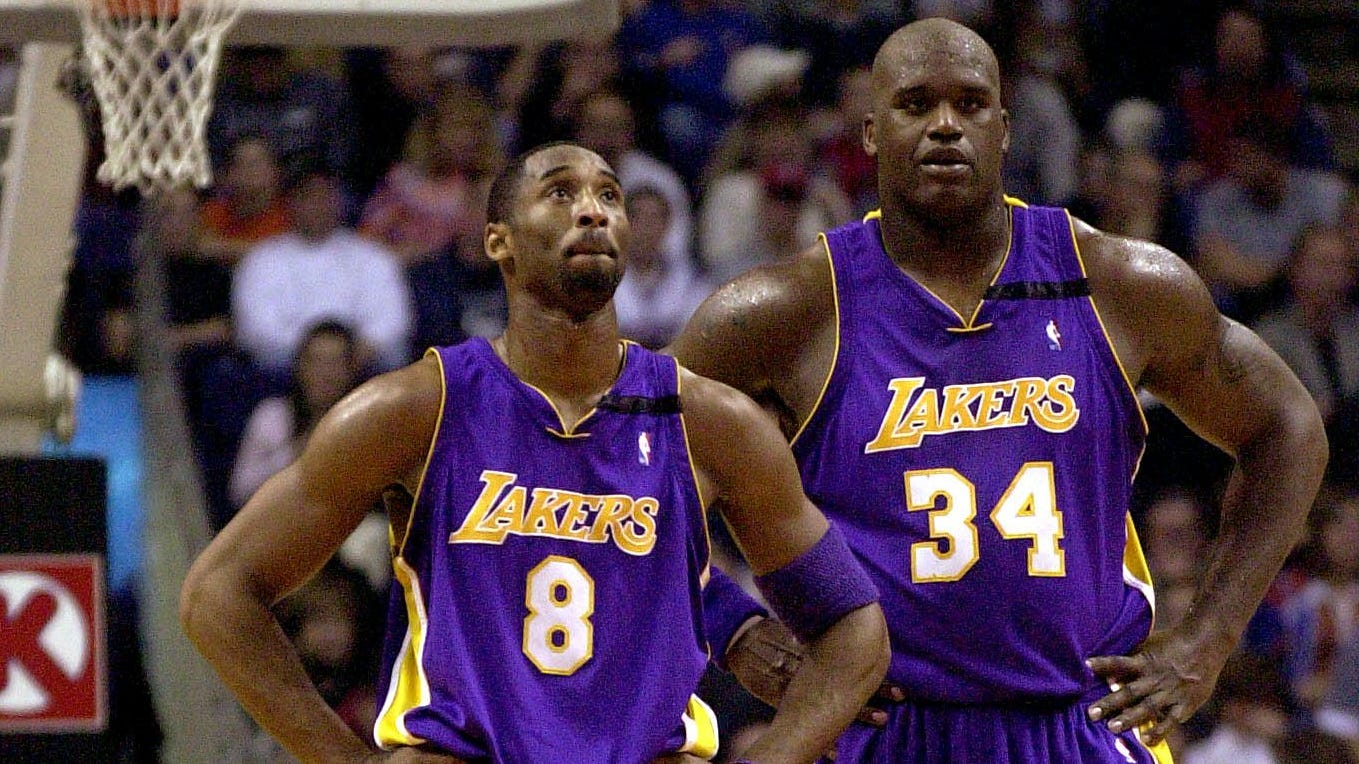 Former teammates Kobe Bryant (8) and Shaquille O'Neal in their heyday.