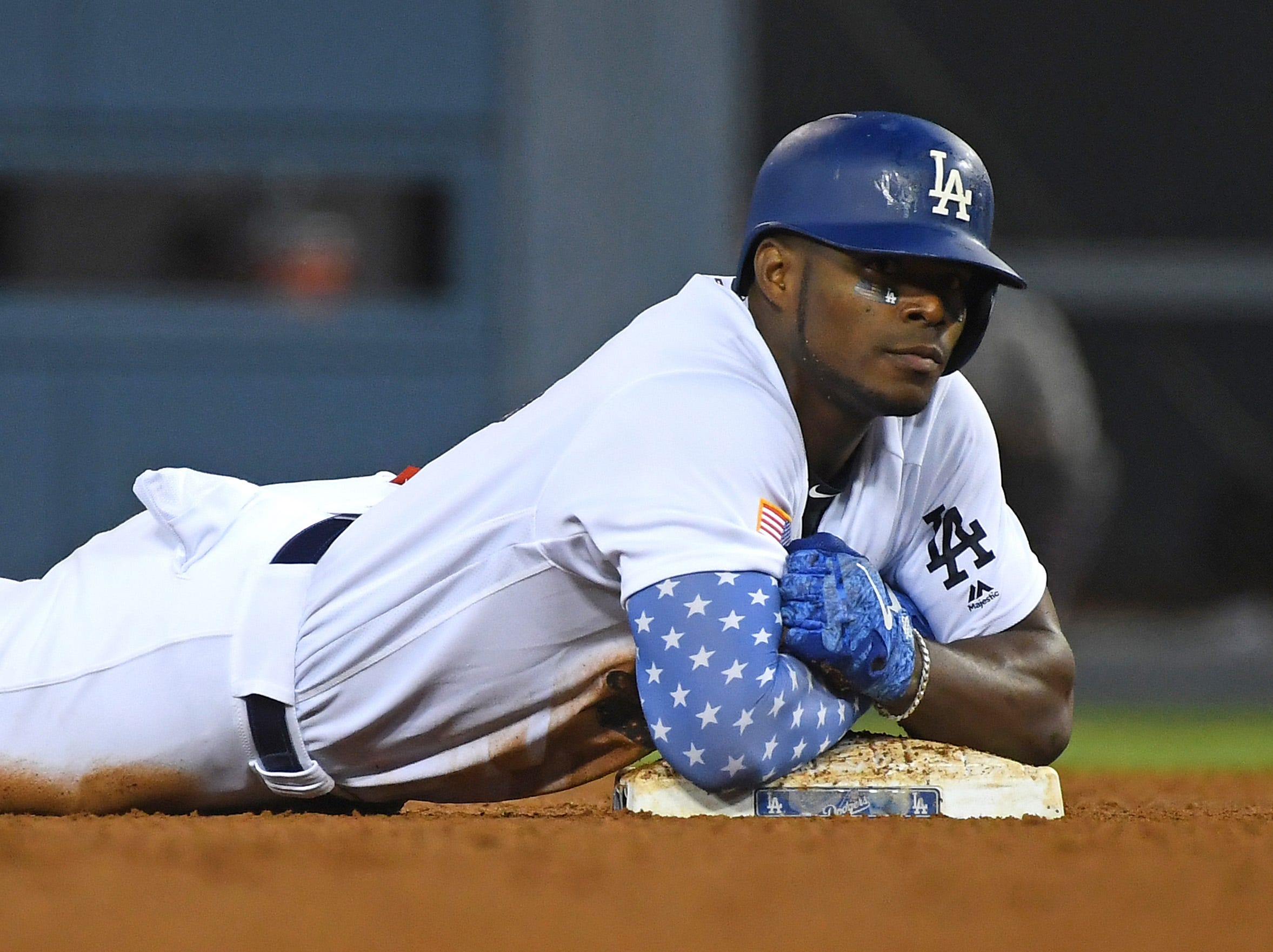 July 2: Los Angeles Dodgers right fielder Yasiel Puig rests on second after hitting a double in the sixth inning of the game against the Pittsburgh Pirates at Dodger Stadium.