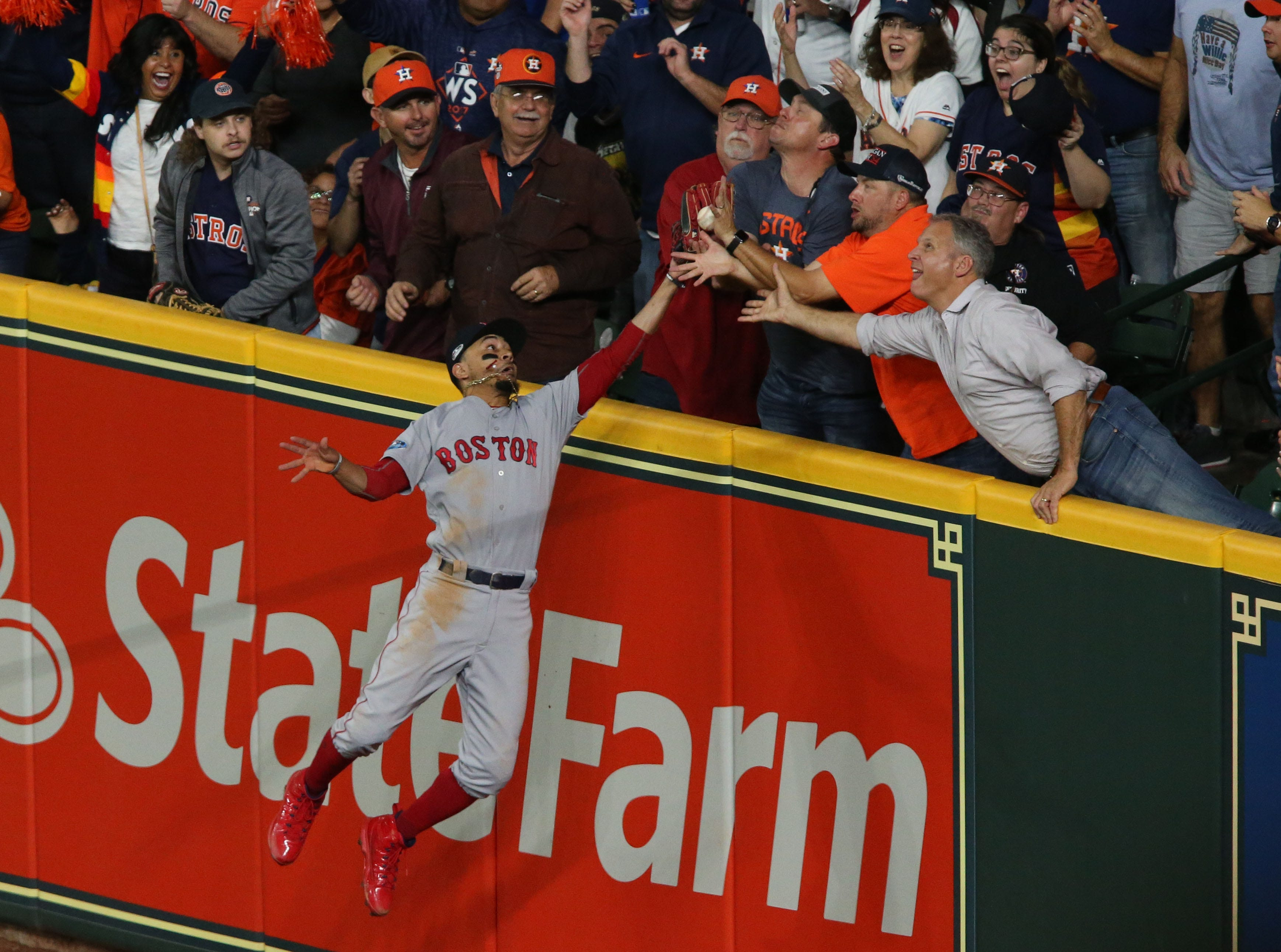 Oct. 17: Houston Astros second baseman Jose Altuve is called out after a fan interfered with Boston Red Sox right fielder Mookie Betts (50) during the first inning in Game 4 of the ALCS.