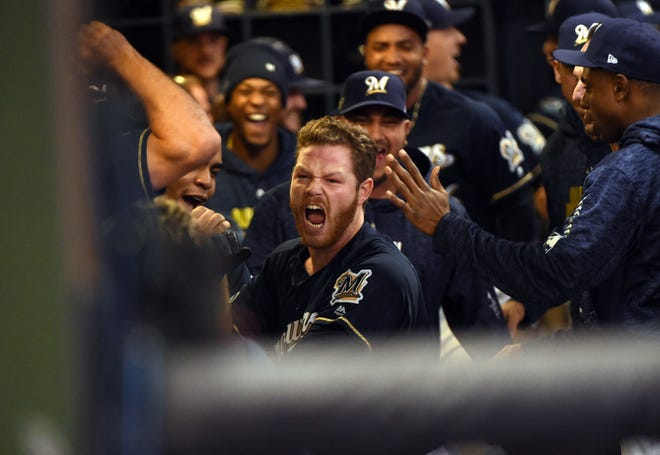 Oct. 12: Milwaukee Brewers relief pitcher Brandon Woodruff  celebrates with in dugout after hitting a solo home run off the Los Angeles Dodgers' Clayton Kershaw during the third inning of Game 1 of the NLCS.