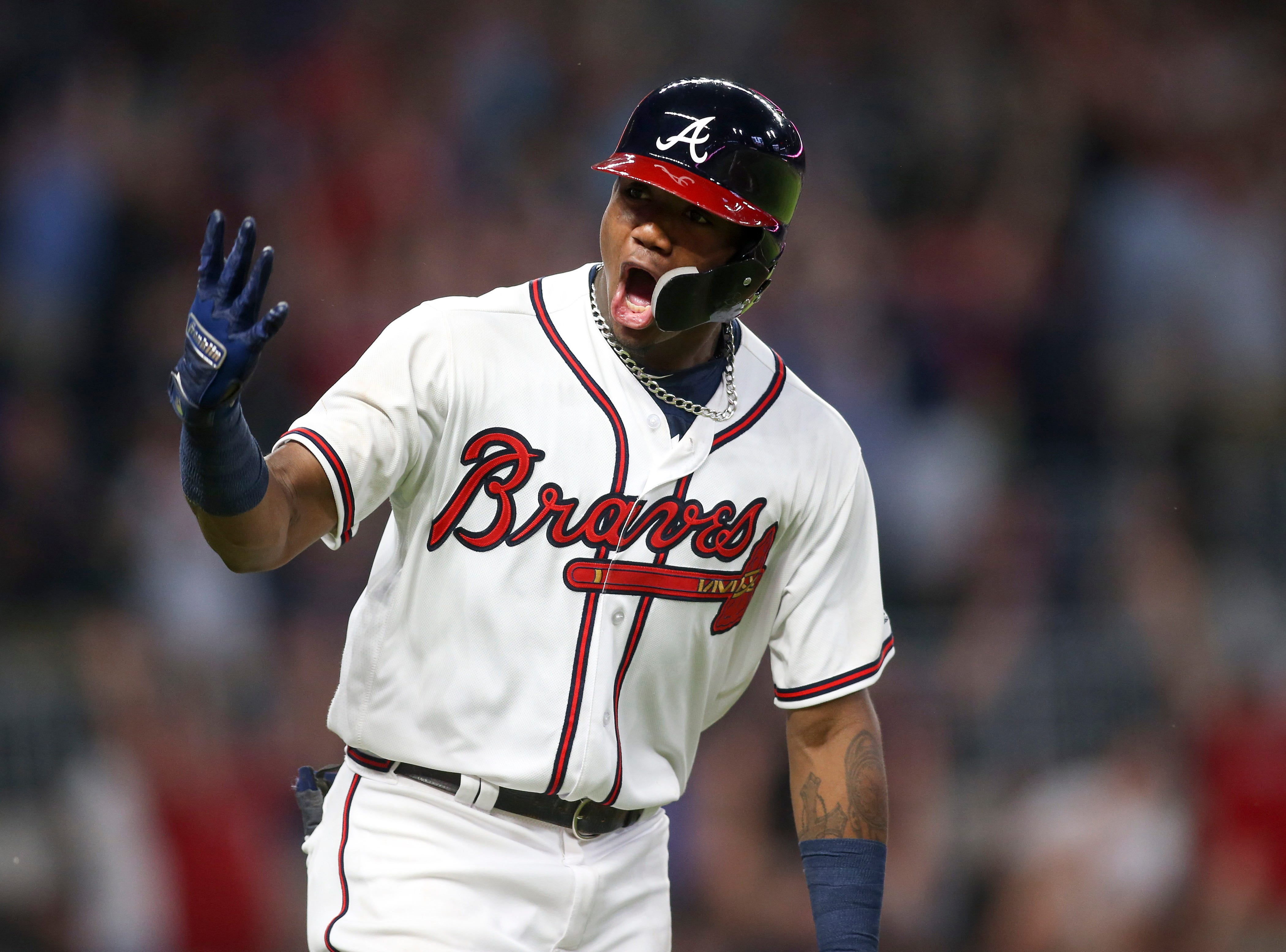 Aug. 14: Atlanta Braves left fielder Ronald Acuna Jr. celebrates after hitting a three-run home run against the Miami Marlins in the seventh inning at SunTrust Park.