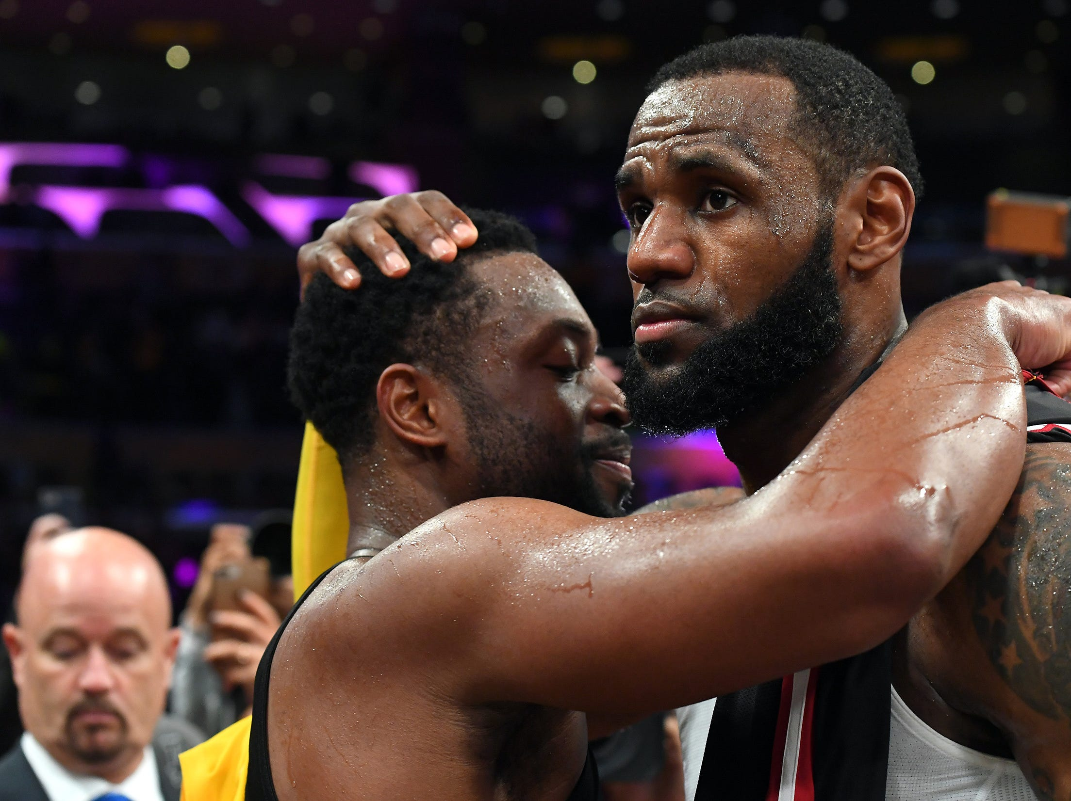 Dec. 10: Miami Heat guard Dwyane Wade (3) and Los Angeles Lakers forward LeBron James (23) embrace after the game at Staples Center.