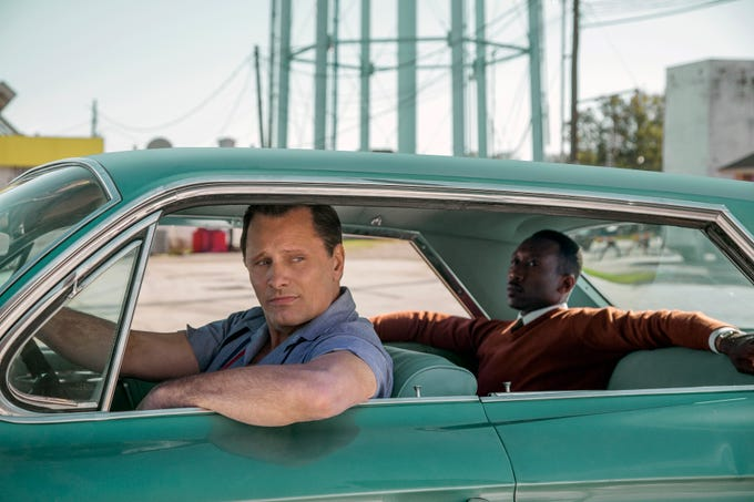"This image released by Universal Pictures shows Viggo Mortensen, left, and Mahershala Ali in a scene from ""Green Book."" On Thursday, Dec. 6, 2018, the film was nominated for a Golden Globe award for best motion picture musical or comedy. The 76th Golden Globe Awards will be held on Sunday, Jan. 6. (Patti Perret/Universal Pictures via AP) ORG XMIT: NYET806"
