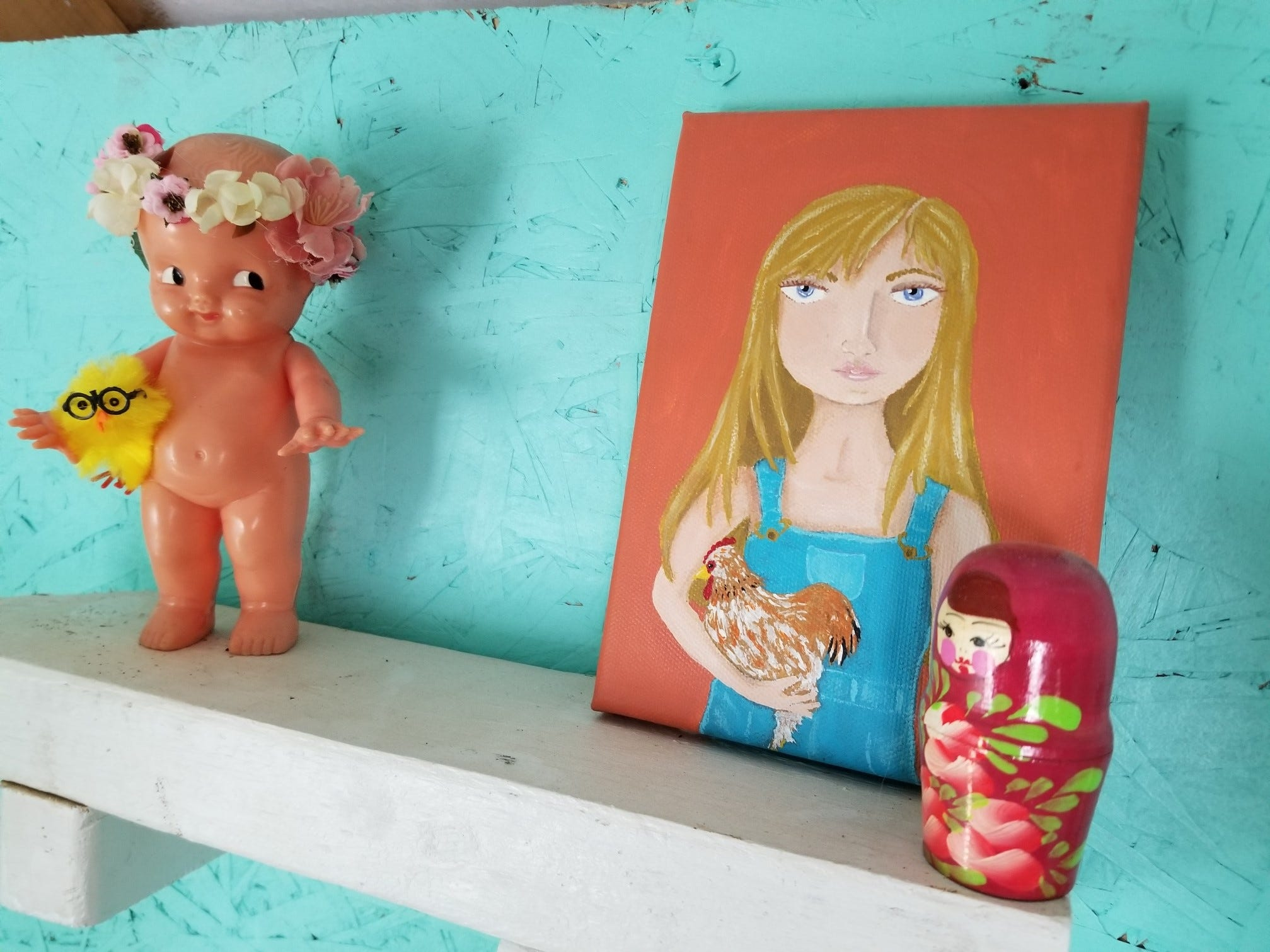 A shelf in Danielle Raad's chicken coop features one of her original paintings and other objects.