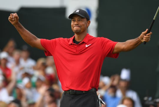 Sept. 23: Tiger Woods celebrates his win in the Tour Championship, his first tournament victory since 2013.