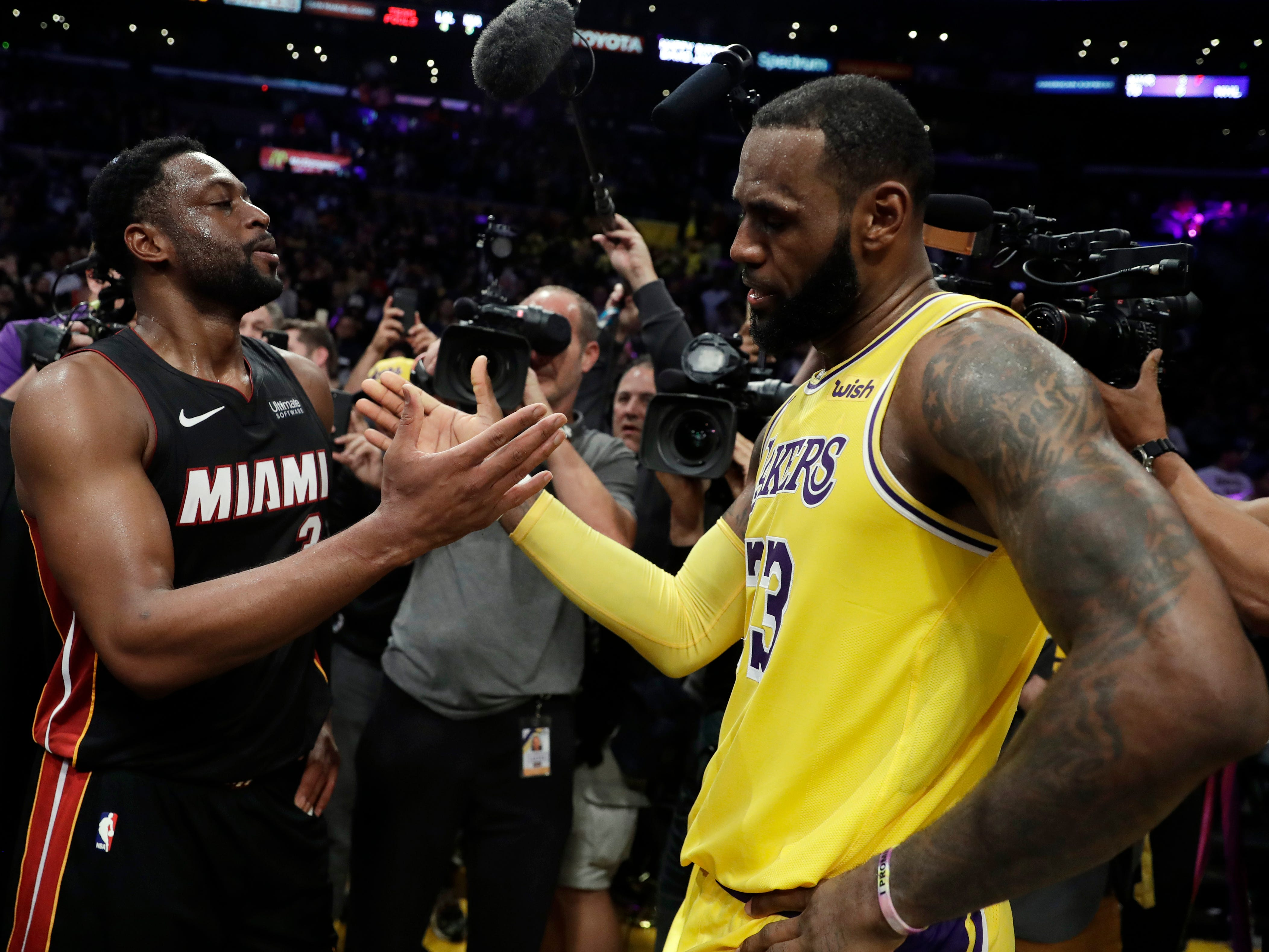Dec. 10, 2018: Dwyane Wade shakes hands with LeBron James after the Lakes defeated the Heat, 108-105, at Staples Center in Los Angeles.