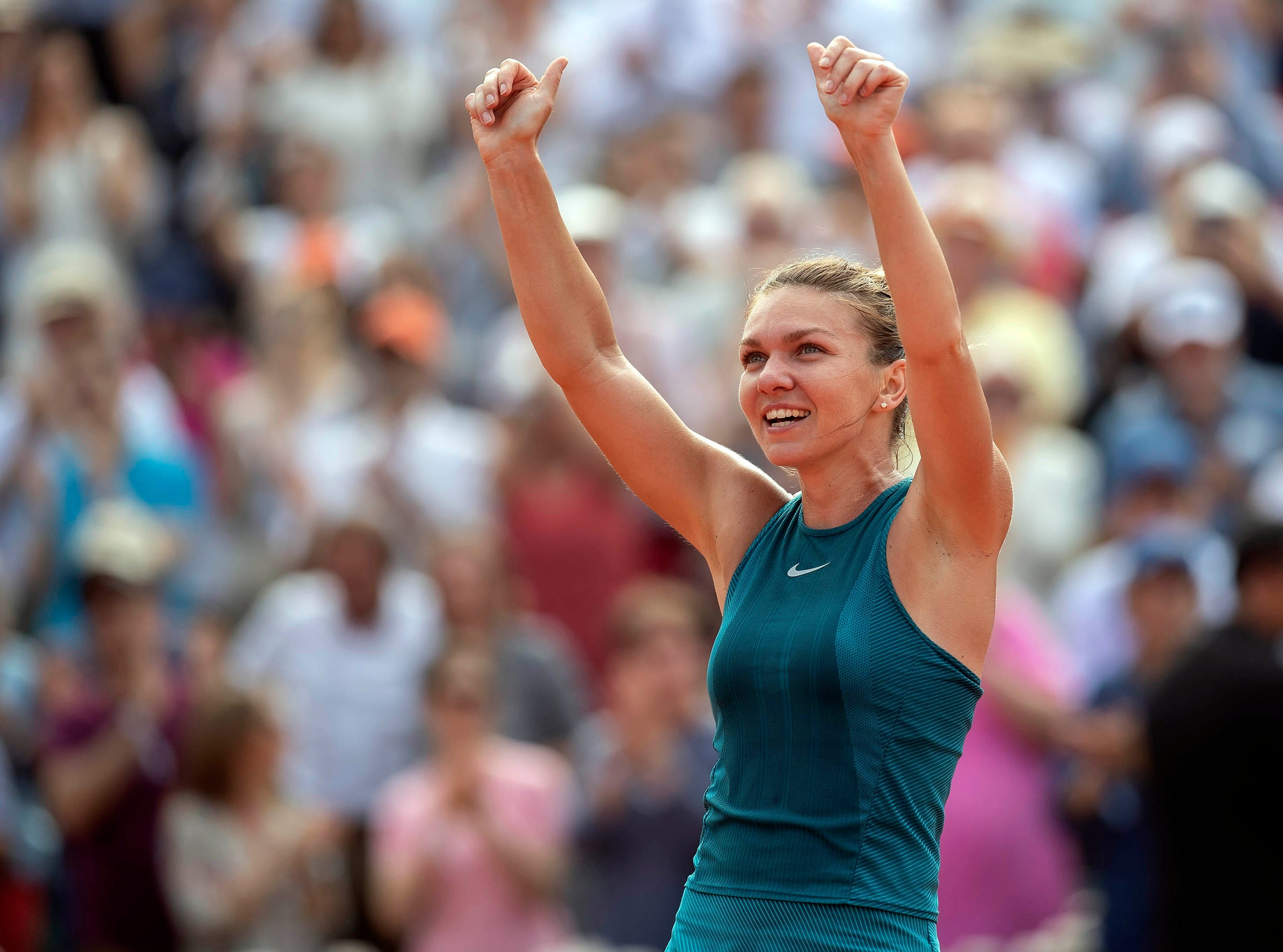 June 9: Simona Halep (ROU) celebrates match point against Sloane Stephens (USA) in the French Open final.