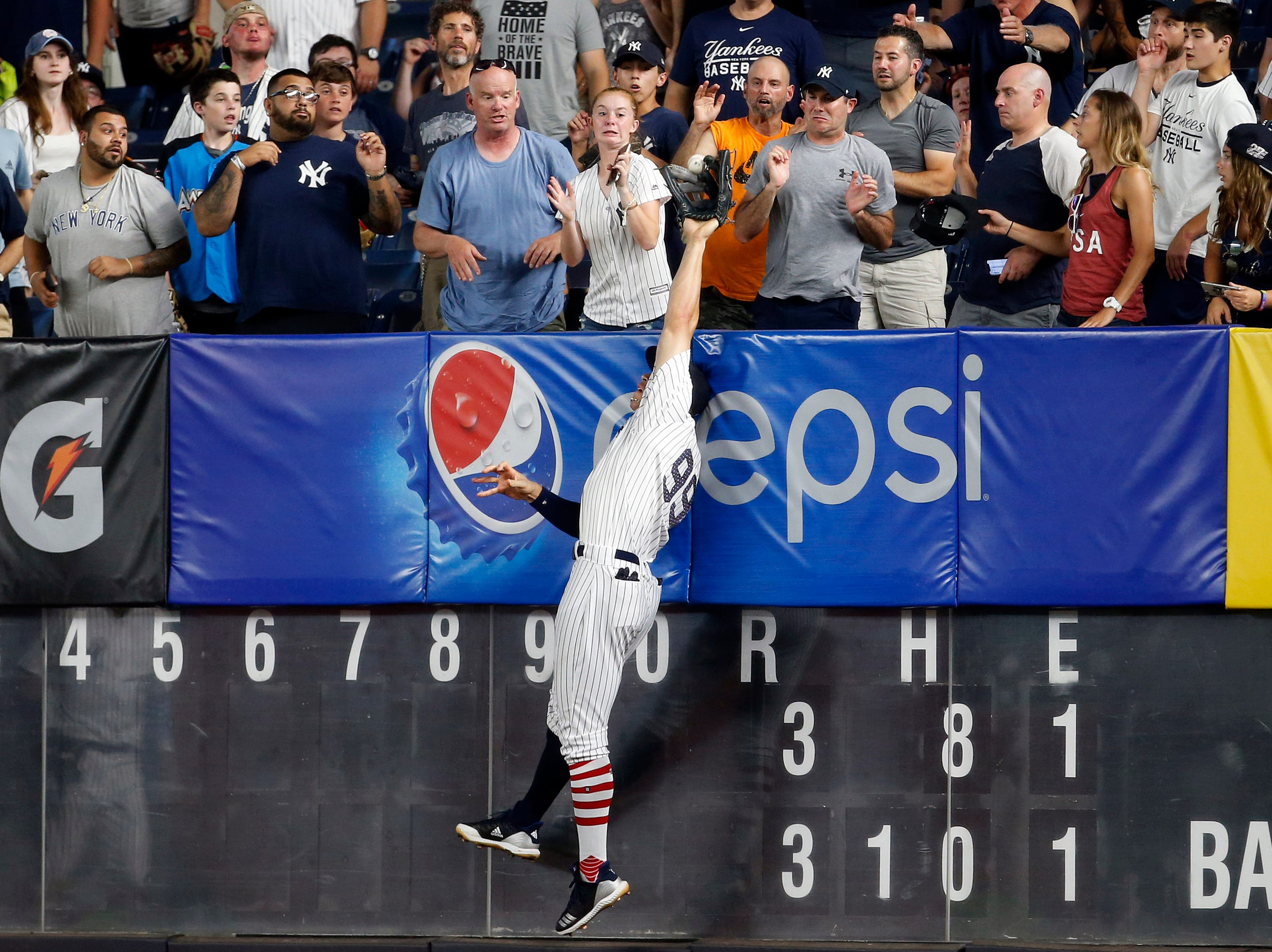 July 2: New York Yankees right fielder Aaron Judge is unable to make a catch on a two-run home run by Atlanta Braves left fielder Ronald Acuna Jr. (13) during the 11th inning at Yankee Stadium.