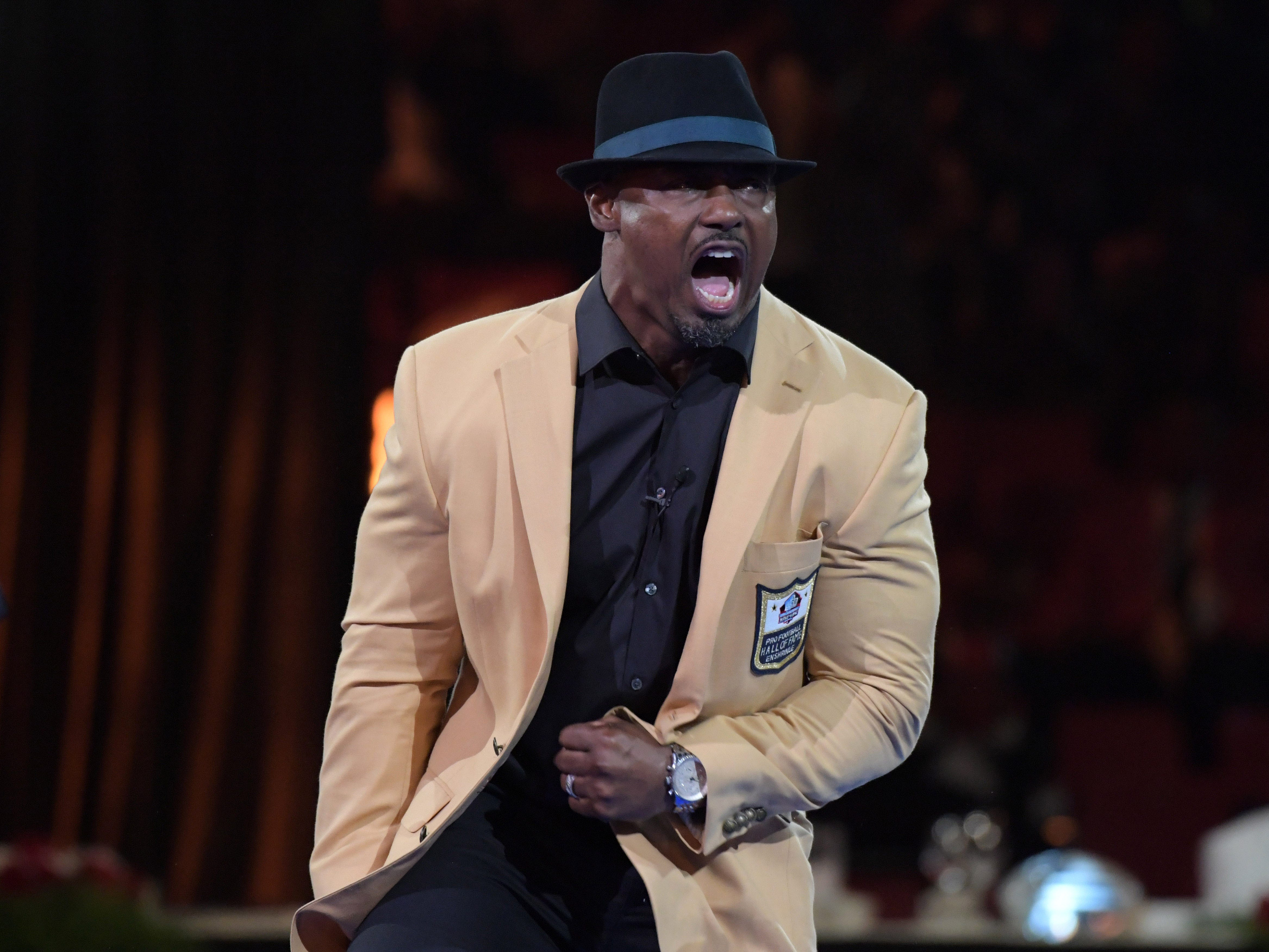 Aug. 3: Brian Dawkins reacts after receiving his gold jacket during the Pro Football Hall of Fame dinner at the Canton Civic Center.