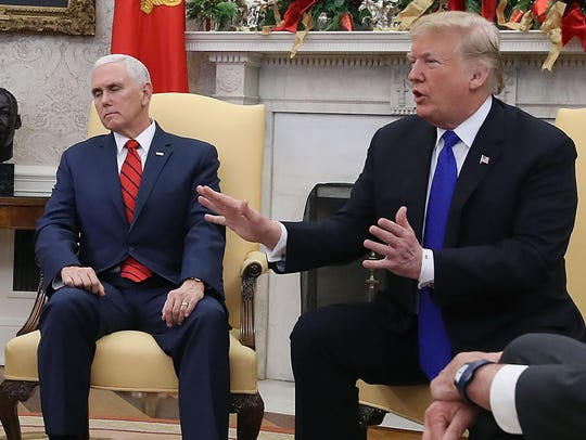 President Donald Trump argues about border security with Senate Minority Leader Chuck Schumer, D-N.Y., and House Minority Leader Nancy Pelosi, D-Calif., as Vice President Mike Pence sits nearby in the Oval Office on Dec. 11, 2018, in Washington.