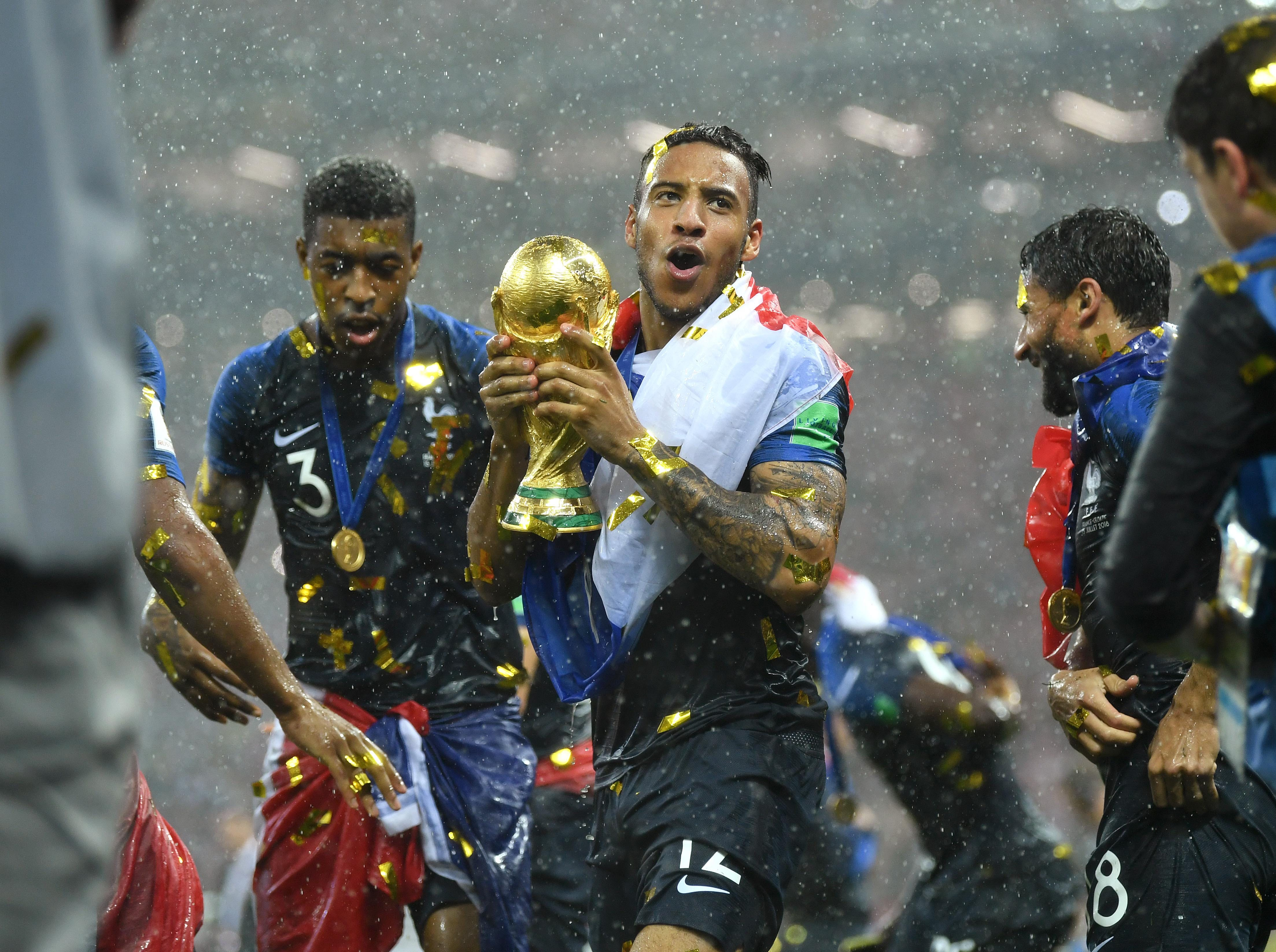 July 15: France midfielder Corentin Tolisso celebrates with the World Cup trophy after defeating Croatia in the final.
