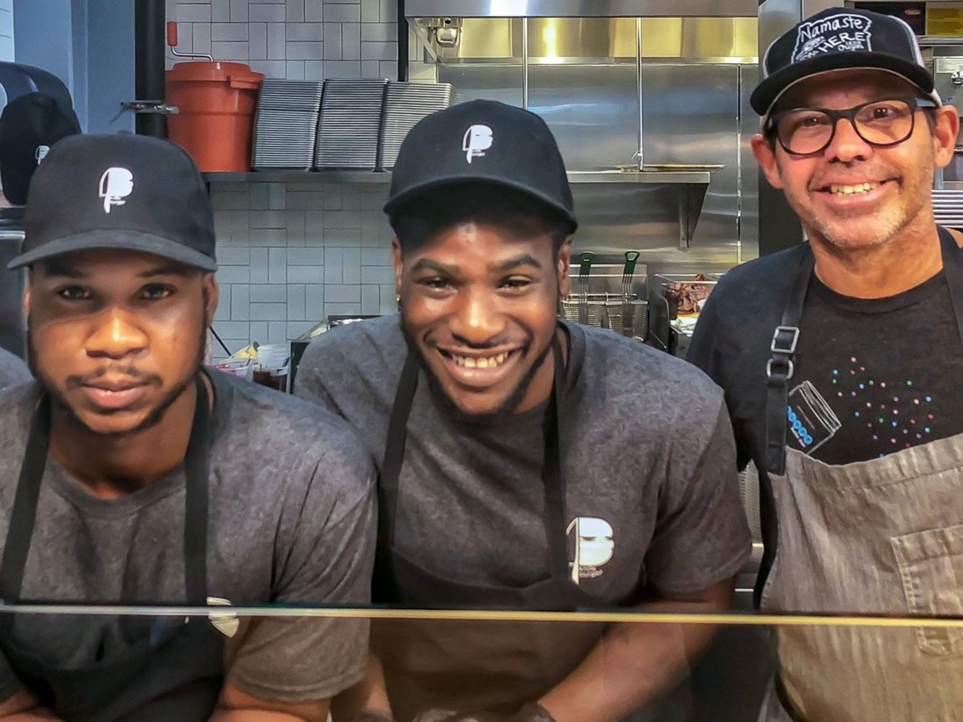 Staff at the original Knife Burger location, including celebrity chef founder John Tesar (right).