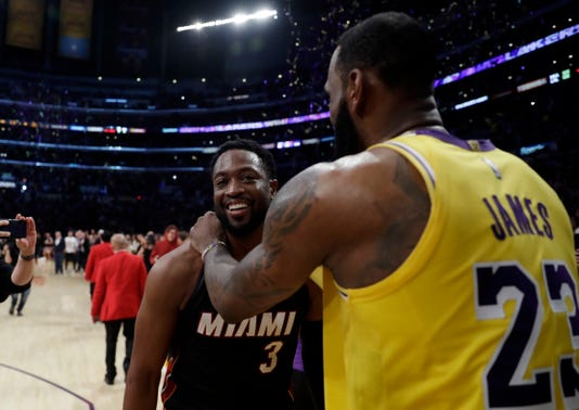07de7812892f Ap Heat Lakers Basketball S Bkn Usa Ca. Miami Heat guard Dwyane Wade hugs  Los Angeles Lakers  LeBron James ...