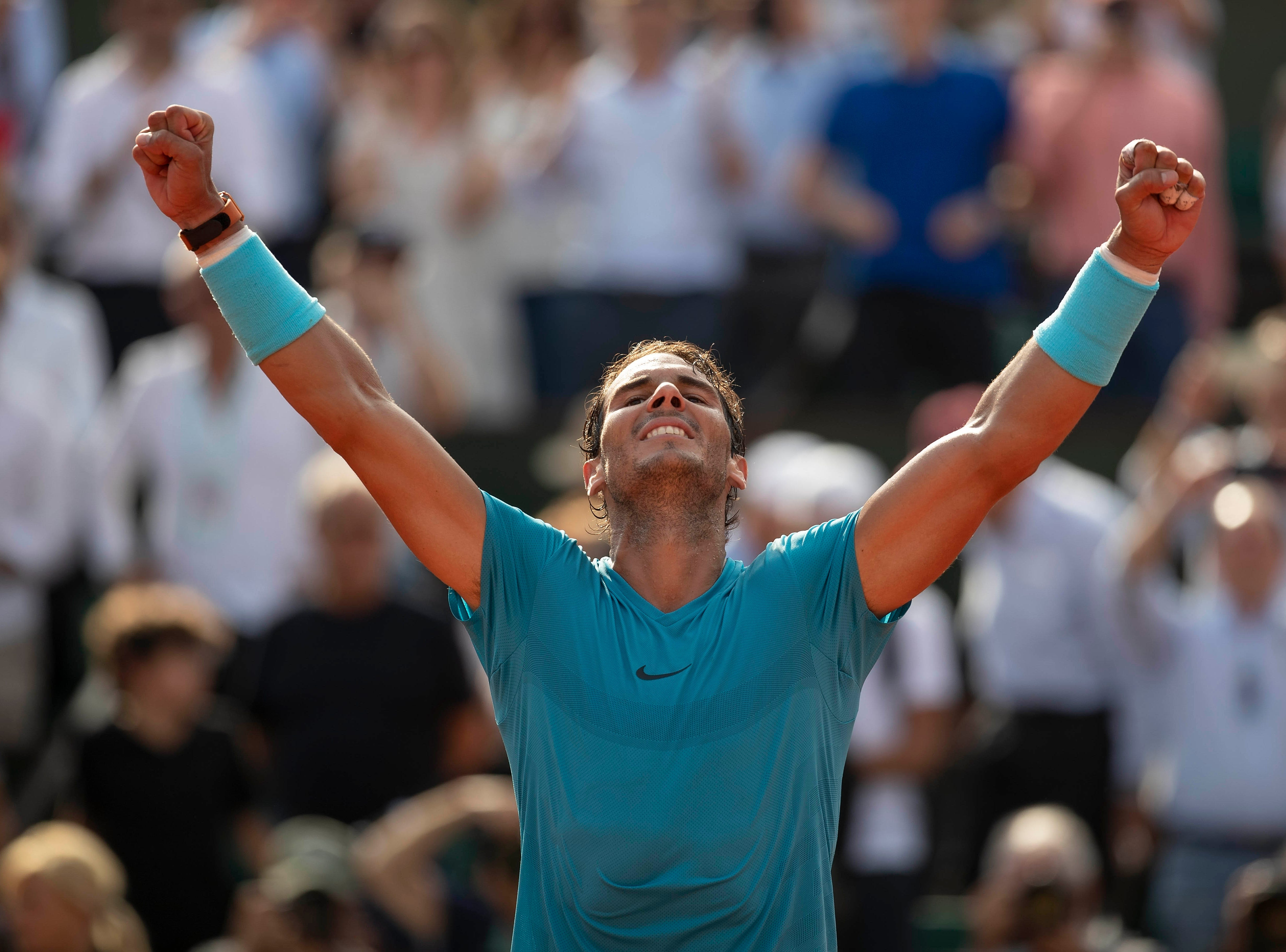 June 8: Rafael Nadal (ESP) celebrates match point during his match against Juan Martin Del Potro (ARG) on Day 13 of the French Open. He would go on to win the championship again.
