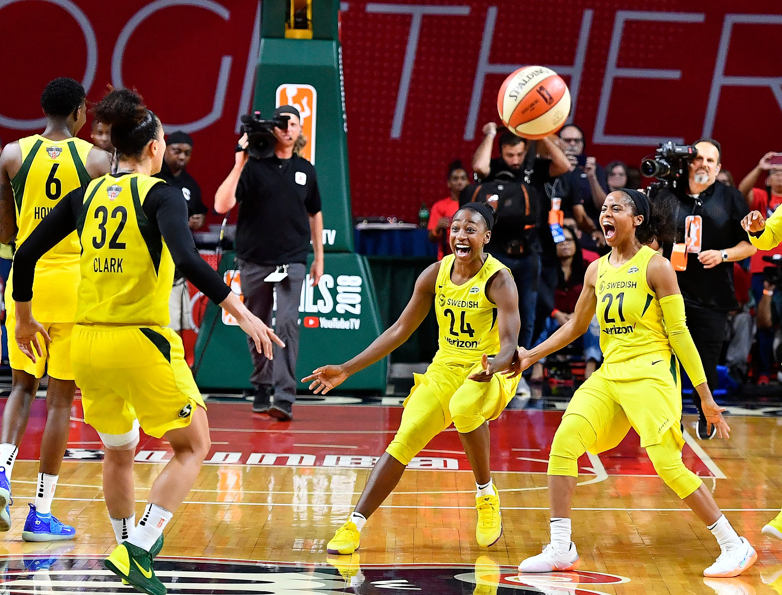 Sept. 12: The Seattle Storm celebrate after defeating the Washington Mystics in Game 3 of the WNBA Finals to win the title.